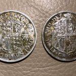 Zwei Silbermünzen und andere